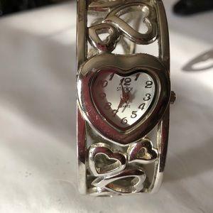 Heart shaped bracelet watch in Silvertone. EUC